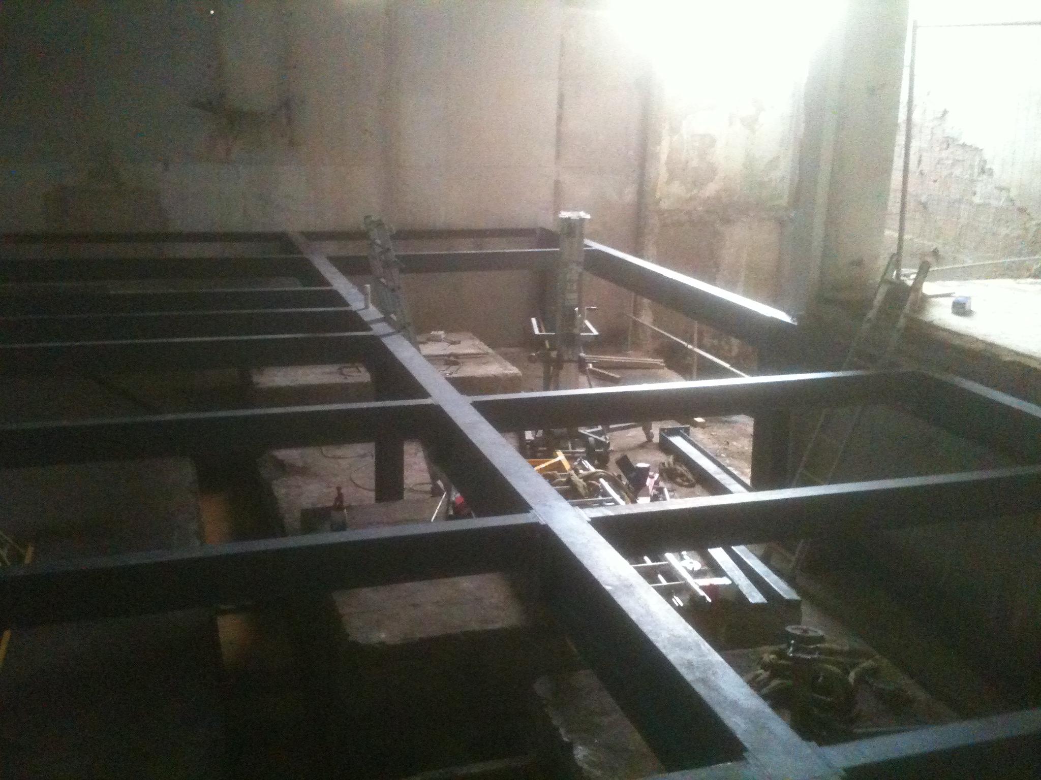 Charpentes et structures m talliques metallerie simon for Porte de garage simon